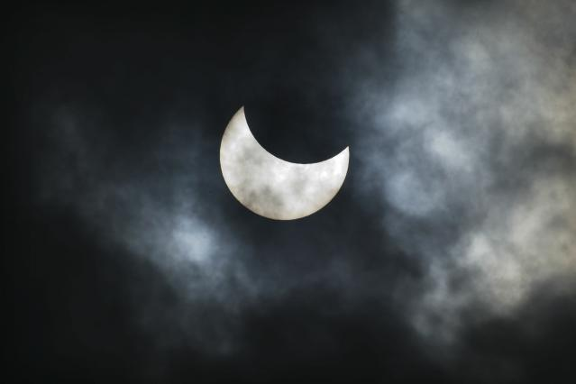 GIVATAYIM, ISRAEL - JANUARY 04: (ISRAEL OUT) The view of a partial solar eclipse in the sky on January 4, 2011 in the town of Givatayim, Israel. Over parts of Europe it could be seen as much as two-thirds of the sun slipped from view behind the moon. An event like this hasn't occurred in the area since August 1999, and the next eclipse won't be until March 2015. (Photo by Uriel Sinai/Getty Images)