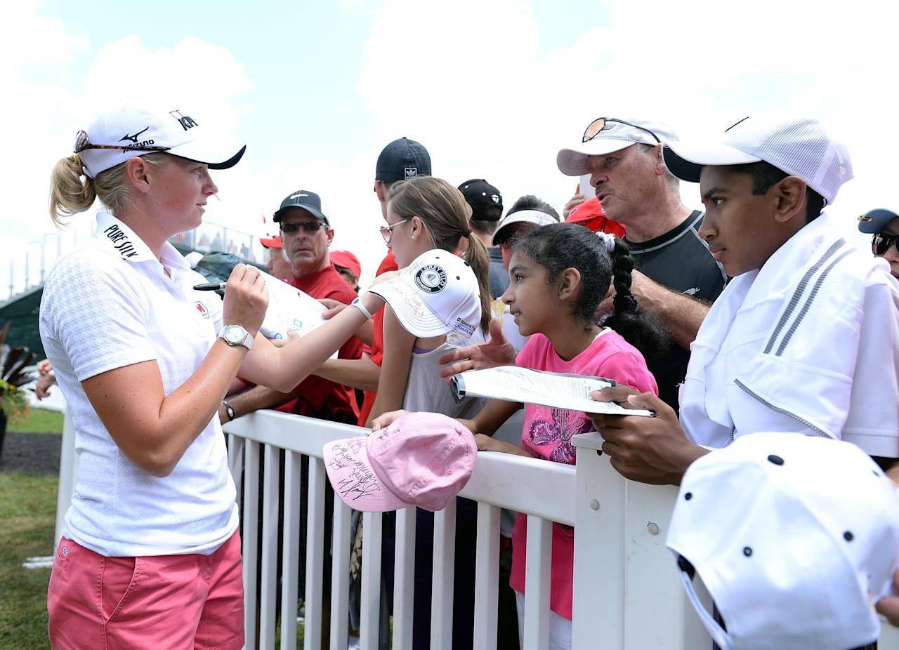 WATERLOO, CANADA - JULY 12: Stacy Lewis signs autographs after round two of the Manulife Financial LPGA Classic at the Grey Silo Golf Course on July 12, 2013 in Waterloo, Canada. (Photo by Harry How/Getty Images)
