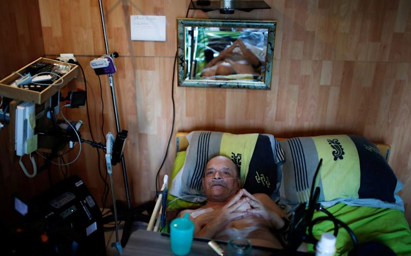 Alain Cocq, 57, suffering from a degenerative disease  - GONZALO FUENTES/ REUTERS