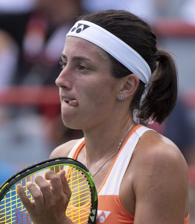 Anastasija Sevastova of Latvia reacts as she faces Sloane Stephens of the United States during quarterfinals play at the Rogers Cup tennis tournament Friday, Aug. 10, 2018 in Montreal. (Paul Chiasson/The Canadian Press via AP)