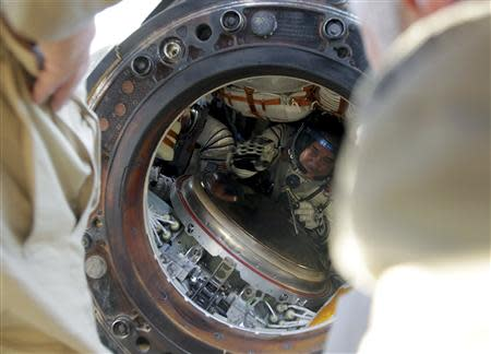 Russian cosmonaut Pavel Vinogradov is seen inside the Soyuz TMA-08M space capsule shortly after it landed some 146 km southeast of the town of Zhezkazgan in Kazakhstan, September 11, 2013. REUTERS/Maxim Shipenkov/Pool