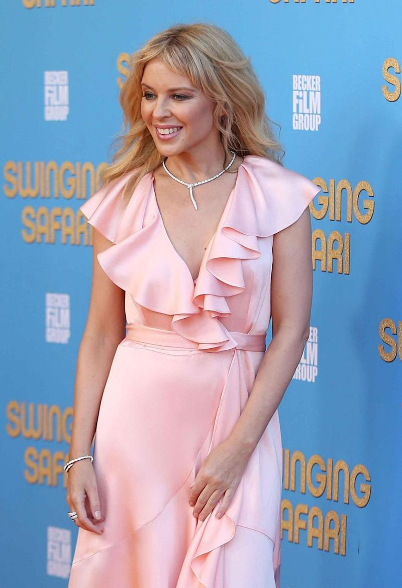Kylie Minogue has revealed her thoughts on swinging. She is pictured looking stunning at the premiere of Swinging Safari. Source: Getty