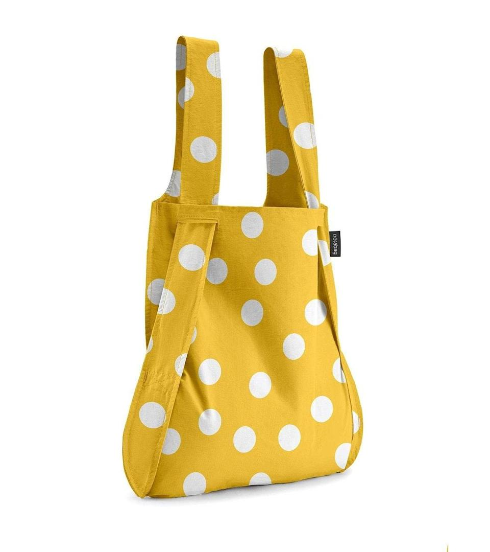 """If you want a lightweight backpack, this convertible tote has your name all over it. We're partial to this <a href=""""https://www.teenvogue.com/story/kendall-jenner-loves-polka-dots?mbid=synd_yahoo_rss"""" rel=""""nofollow noopener"""" target=""""_blank"""" data-ylk=""""slk:polka dot"""" class=""""link rapid-noclick-resp"""">polka dot</a> option, but you can shop the <a href=""""https://notabag.us/"""" rel=""""nofollow noopener"""" target=""""_blank"""" data-ylk=""""slk:entire site"""" class=""""link rapid-noclick-resp"""">entire site</a> for a variety of colors and prints. $28, Notabag. <a href=""""https://notabag.us/collections/notabag-original/products/notabag-golden-dots"""" rel=""""nofollow noopener"""" target=""""_blank"""" data-ylk=""""slk:Get it now!"""" class=""""link rapid-noclick-resp"""">Get it now!</a>"""