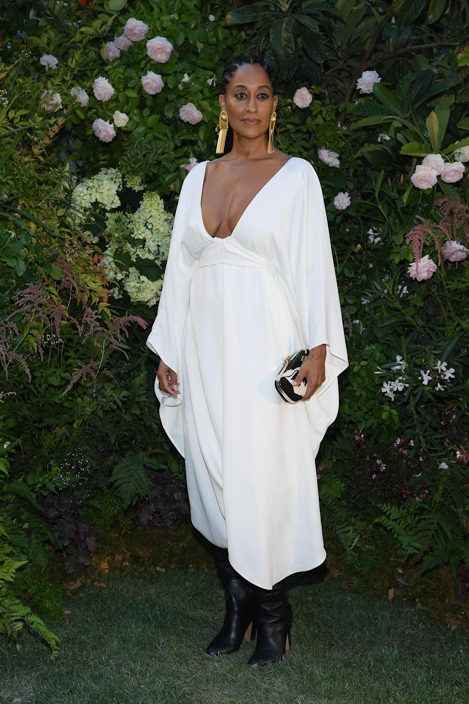 <p>Tracee Ellis Ross gave us major style inspo in a draped dress and supersized gold earrings at the Valentino show in Paris on 4 July <em>[Photo: Getty]</em> </p>