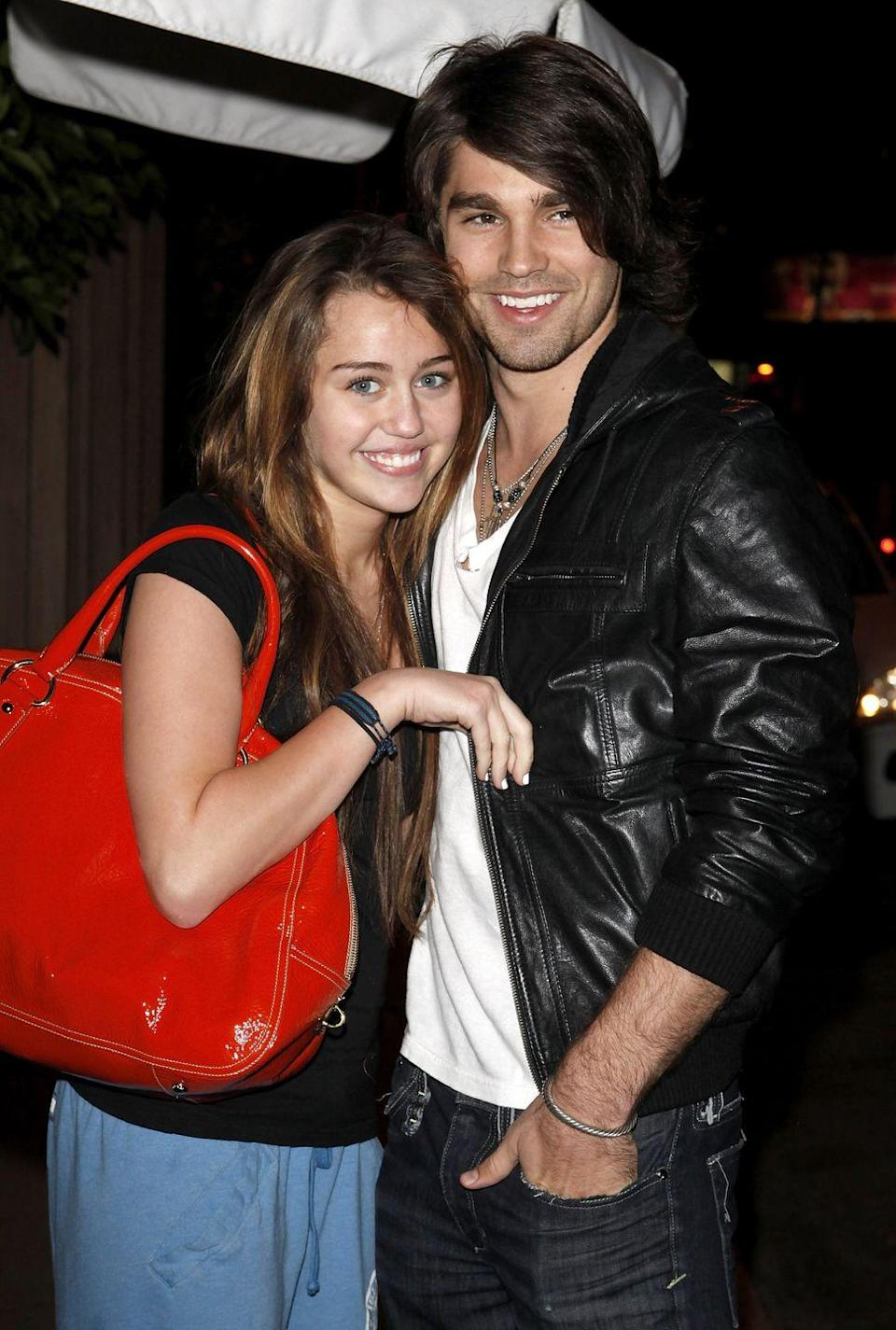"""<p>Then 16-year-old Cyrus found love with 20-year-old Justin Gaston, a contestant on her dad's reality show <em>Nashville Star</em>. They dated for nine months before splitting in June 2009. <a href=""""https://www.eonline.com/news/128212/miley_cyrus_justin_gaston_are_totally"""" rel=""""nofollow noopener"""" target=""""_blank"""" data-ylk=""""slk:Sources told E!"""" class=""""link rapid-noclick-resp"""">Sources told E!</a> at the time that Cyrus's newfound friendship with Jonas may have contributed to the breakup. """"She obviously has been hanging out with Nick again a lot, and Justin was cool with it at first, as long as it was just a cool, friendly thing,"""" the insider said. """"She didn't cheat, but I guess Nick was trying to get her back the whole time."""" Then, Cyrus jetted to Savannah, Georgia to film <em>The Last Song</em>. <br></p>"""