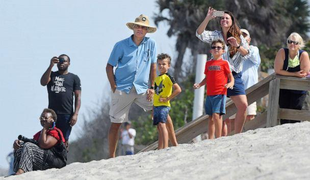 PHOTO: Spectators across from Patrick Air Force Base watch the Tuesday afternoon SpaceX Falcon 9 rocket launch from Cape Canaveral.<p>Spacex Launch Spectators (Tim Shortt/Florida Today via USA Today Network)</p>