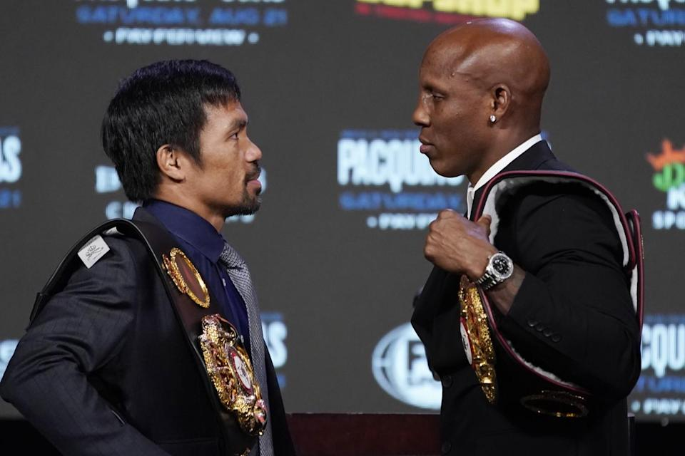 Manny Pacquiao, left, and Yordenis Ugas pose for photographers during a news conference Wednesday in Las Vegas.