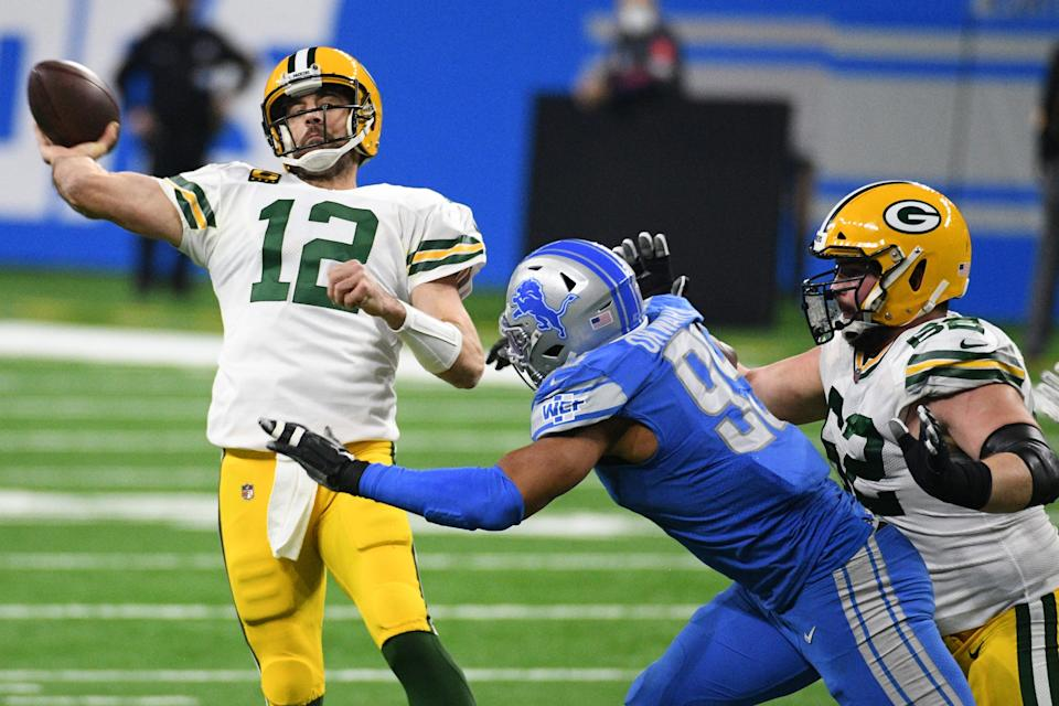 Green Bay Packers quarterback Aaron Rodgers (12) drops back to pass during the third quarter against the Detroit Lions at Ford Field.