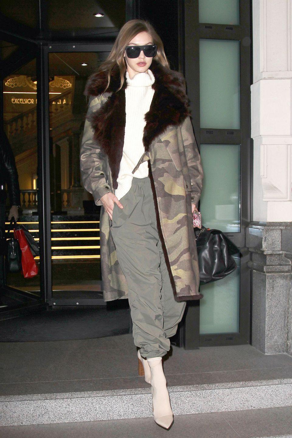 <p>While out in Milan during Fashion Week, Gigi bundled up in an oversized camouflage coat, ivory cashmere turtleneck by Stephanie Rad, olive green joggers and Tony Bianco ankle boots. </p>