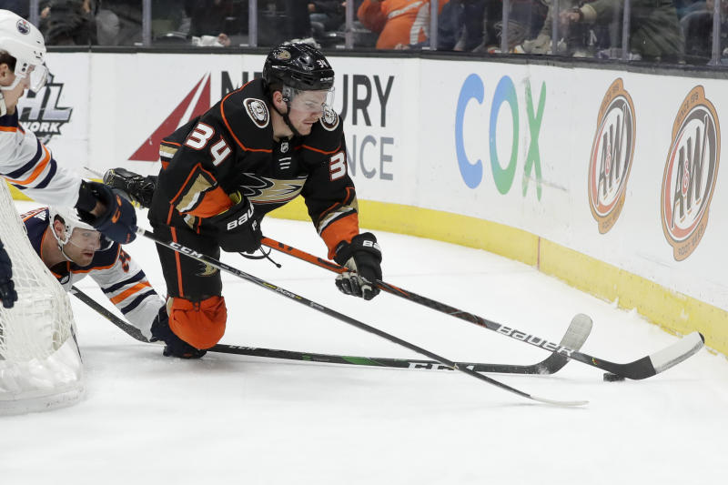 Anaheim Ducks center Sam Steel, top, battles Edmonton Oilers right wing Patrick Russell for the puck during the first period of an NHL hockey game in Anaheim, Calif., Tuesday, Feb. 25, 2020. (AP Photo/Chris Carlson)