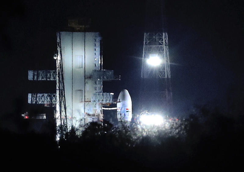 """Indian Space Research Organization (ISRO)'s Geosynchronous Satellite launch Vehicle (GSLV) MkIII carrying Chandrayaan-2 stands at Satish Dhawan Space Center after the mission was aborted at the last minute at Sriharikota, in southern India, Monday, July 15, 2019. India has called off the launch of a moon mission to explore the lunar south pole. The Chandrayaan-2 mission was aborted less than an hour before takeoff on Monday. An Indian Space Research Organization spokesman says a """"technical snag"""" was observed in the 640-ton launch-vehicle system. (AP Photo/Manish Swarup)"""