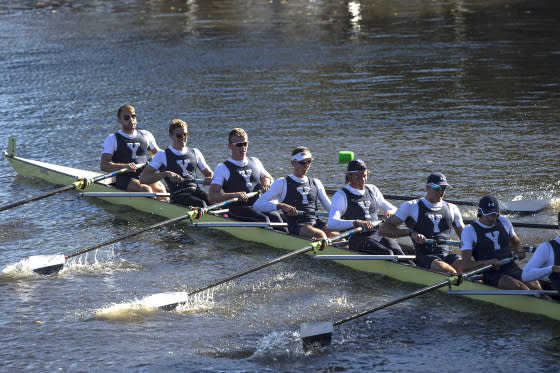 Members of the Yale championship eight crew team make their way up the Charles River during the 52nd Head of the Charles Regatta on the Charles River in Cambridge, Mass., on Oct. 23, 2016.