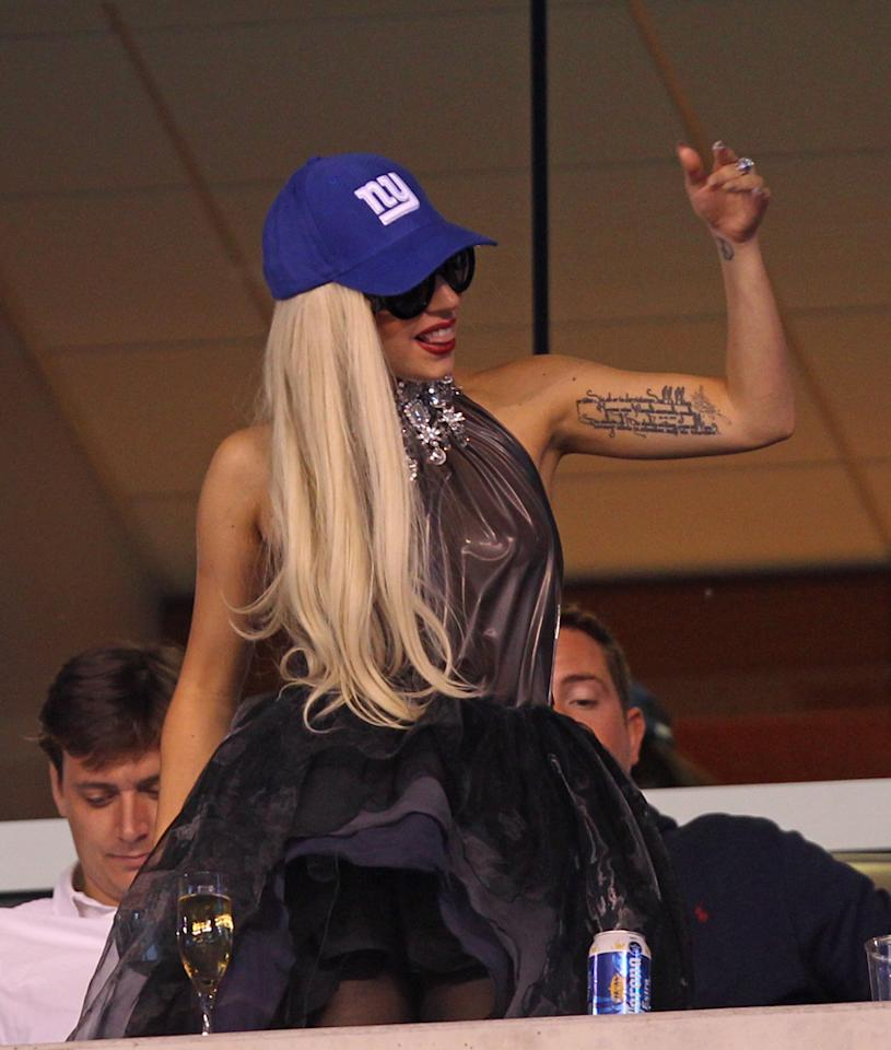 """Lady Gaga caused a commotion Monday night while watching her home team, the New York Giants, battle the St. Louis Rams at the MetLife Stadium in East Rutherford, New Jersey. The """"Edge of Glory"""" songstress -- who, not surprisingly, donned a bejeweled ball gown -- sipped champagne and waved to her adoring fans throughout the football game. Wenzelberg/NY Post/<a href=""""http://www.splashnewsonline.com"""" target=""""new"""">Splash News</a> - September 20, 2011"""