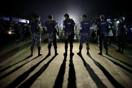 Security personnel block a road outside the Kashimpur jail during the execution of three Islamists in Dhaka