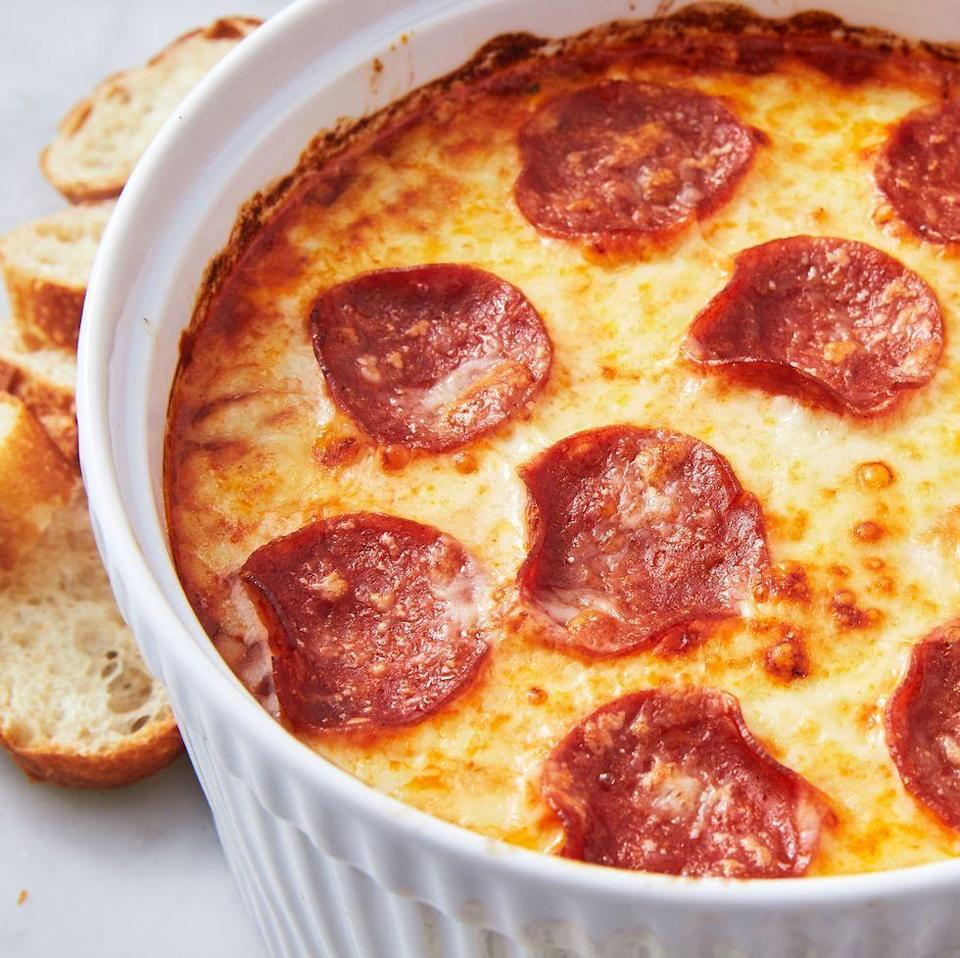 """<p>A <a href=""""https://www.delish.com/uk/food-news/a29412360/leftover-pizza/"""" rel=""""nofollow noopener"""" target=""""_blank"""" data-ylk=""""slk:pizza"""" class=""""link rapid-noclick-resp"""">pizza</a> dip is obviously good, but a MEAT LOVERS' pizza dip? That's next-level good. This dip is super simple to make, and everyone will love it. We used sausage, bacon, and pepperoni but use whatever types of meat you prefer! </p><p>Get the <a href=""""https://www.delish.com/uk/cooking/recipes/a31952069/pizza-dip-recipe/"""" rel=""""nofollow noopener"""" target=""""_blank"""" data-ylk=""""slk:Meat Lovers' Pizza Dip"""" class=""""link rapid-noclick-resp"""">Meat Lovers' Pizza Dip</a> recipe.</p>"""