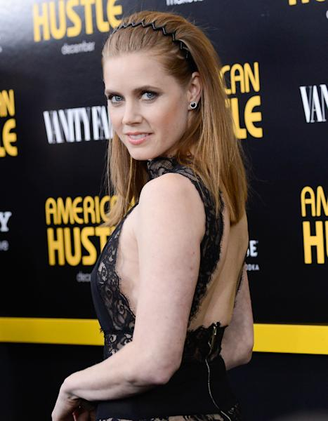 "FILE - This Dec. 8, 2013 file photo shows actress Amy Adams at the premiere of ""American Hustle"" at the Ziegfeld Theatre in New York. Adams was nominated for an Academy Award for best actress on Thursday, Jan. 16, 2014, for her role in the film. The 86th Academy Awards will be held on March 2. (Photo by Evan Agostini/Invision/AP, File)"