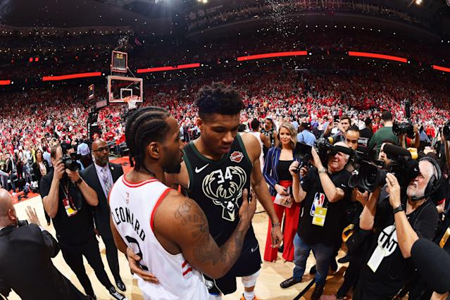Toronto Raptors' Kawhi Leonard, left, meets with Milwaukee Bucks' Giannis Antetokounmpo after Game 6 of the East finals (Getty Images)