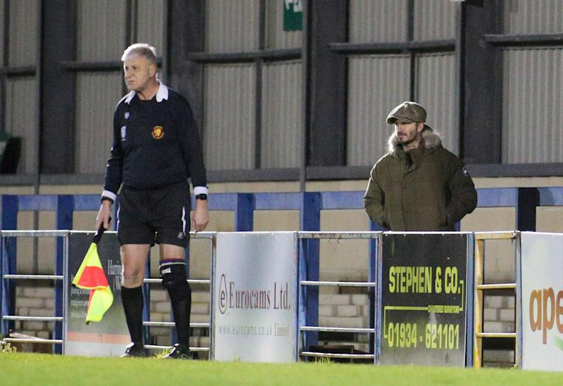 Clad in a Canada Goose coat, jeans and baker boy hat, the 44-year-old made his way around the ground to get the best view of the action after paying £3 to get in. (Jon Mills / SWNS)