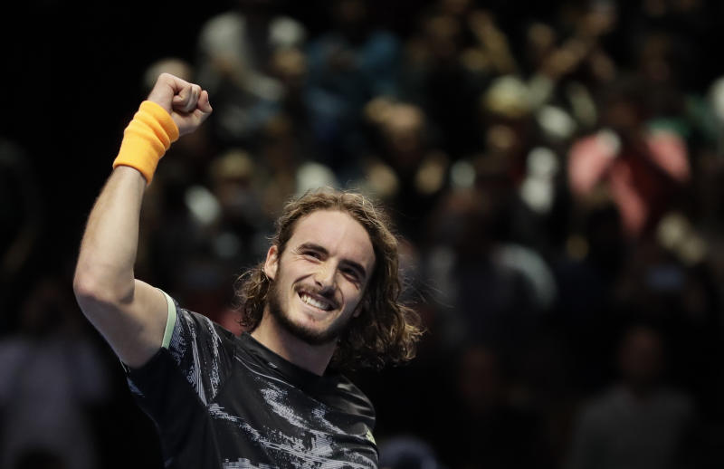 Stefanos Tsitsipas of Greece celebrates winning match point against Roger Federer of Switzerland during their ATP World Tour Finals semifinal tennis match at the O2 Arena in London, Saturday, Nov. 16, 2019. (AP Photo/Kirsty Wigglesworth)