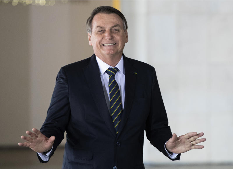 Brazil's President Jair Bolsonaro gestures as he welcomes leaders of the BRICS emerging economies at the Itamaraty palace in Brasilia, Brazil, Thursday, Nov. 14, 2019. (AP Photo/Pavel Golovkin, Pool)