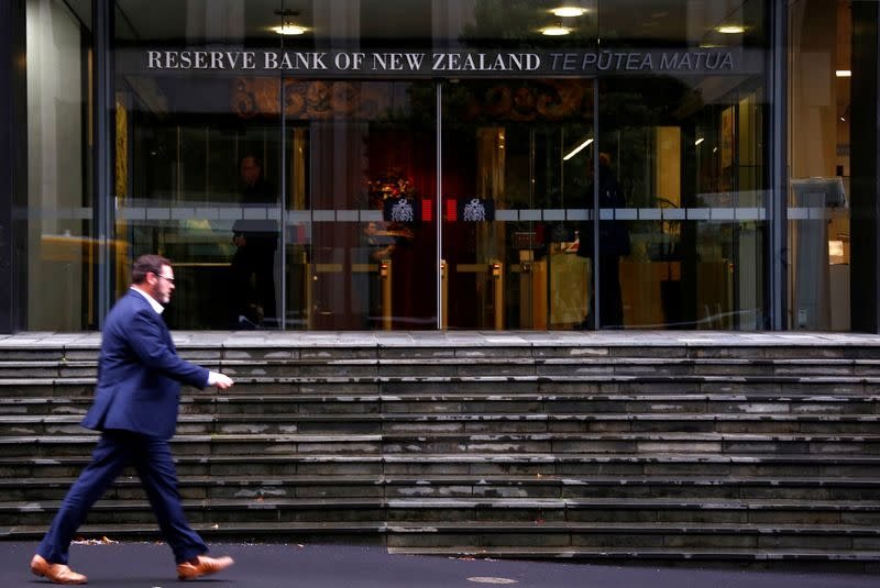 A pedestrian walks past the main entrance to the Reserve Bank of New Zealand located in central Wellington, New Zealand