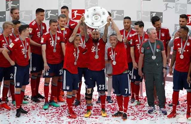 Soccer Football - Bundesliga - Bayern Munich v VfB Stuttgart - Allianz Arena, Munich, Germany - May 12, 2018 Bayern Munich's Arturo Vidal, Rafinha and Franck Ribery celebrate winning the Bundesliga with the trophy REUTERS/Michaela Rehle DFL RULES TO LIMIT THE ONLINE USAGE DURING MATCH TIME TO 15 PICTURES PER GAME. IMAGE SEQUENCES TO SIMULATE VIDEO IS NOT ALLOWED AT ANY TIME. FOR FURTHER QUERIES PLEASE CONTACT DFL DIRECTLY AT + 49 69 650050