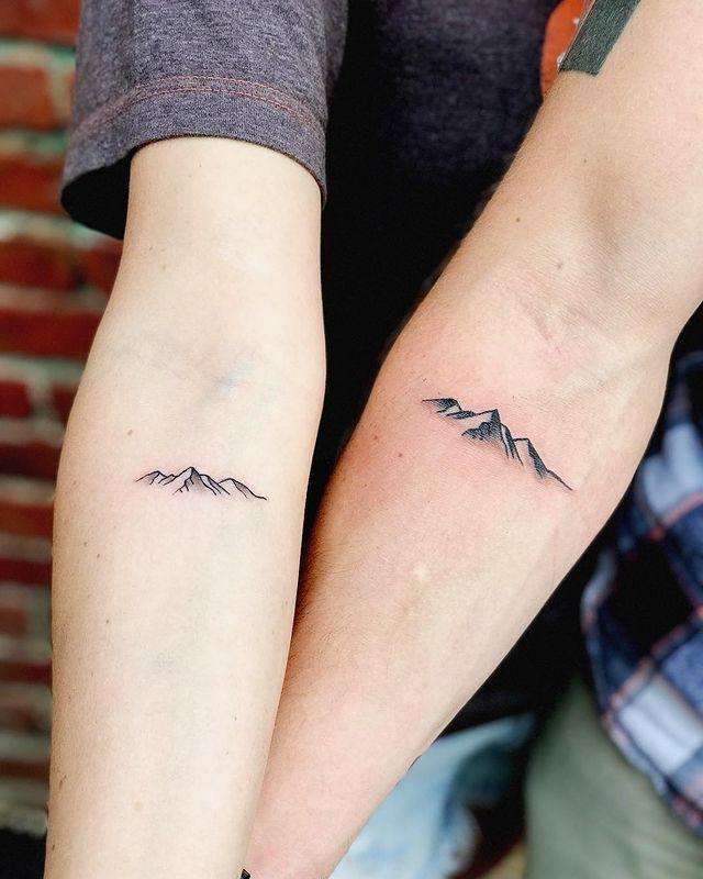 """<p>If the mountains are a special places for you and your partner, you two will love the simplicity of this couples tattoo.</p><p><a href=""""https://www.instagram.com/p/BZeAn8Pgse2/?utm_source=ig_embed&utm_campaign=loading"""" rel=""""nofollow noopener"""" target=""""_blank"""" data-ylk=""""slk:See the original post on Instagram"""" class=""""link rapid-noclick-resp"""">See the original post on Instagram</a></p>"""