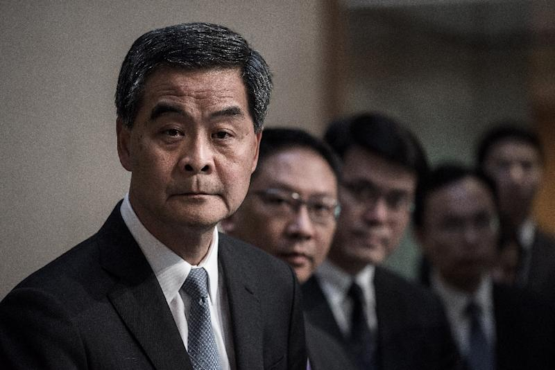 Hong Kong Chief Executive Leung Chun-ying (left) addresses a press conference in Hong Kong on June 18, 2015 (AFP Photo/Philippe Lopez)