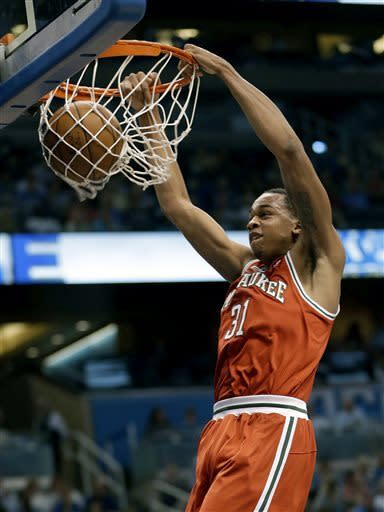 Milwaukee Bucks' John Henson (31) make an uncontested dunk against the Orlando Magic during the first half of an NBA basketball game, Wednesday, April 10, 2013, in Orlando, Fla. (AP Photo/John Raoux)