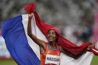 Sifan Hassan, of the Netherlands, celebrates as after winning the women's 5,000-meters final at the 2020 Summer Olympics, Monday, Aug. 2, 2021, in Tokyo. (AP Photo/Francisco Seco)