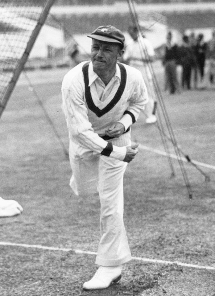 Australian cricketer Don Bradman in action bowling. Sir Donald Bradman (1908 - 2001) was the first cricketer to be knighted in 1949 for his services to cricket.   (Photo by Central Press/Getty Images)