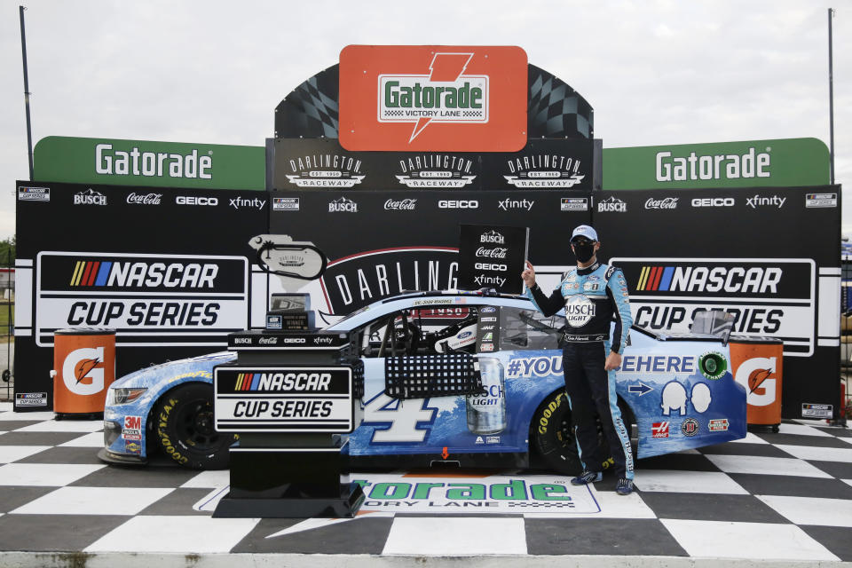 Kevin Harvick celebrates in victory lane after winning the NASCAR Cup Series auto race Sunday, May 17, 2020, in Darlington, S.C. (AP Photo/Brynn Anderson)