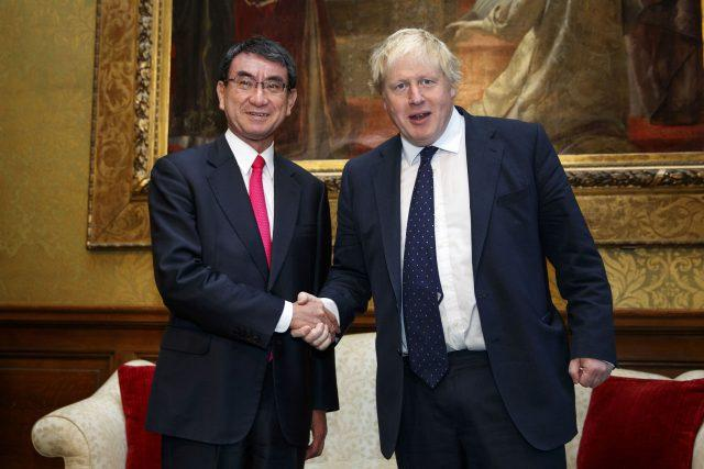 Boris Johnson shakes hands with Japan's Foreign Minister Taro Kono at the Foreign office in London (Tolga Akmen/PA)