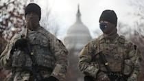 US National Guardsmen stand on a closed street outside the Capitol Building