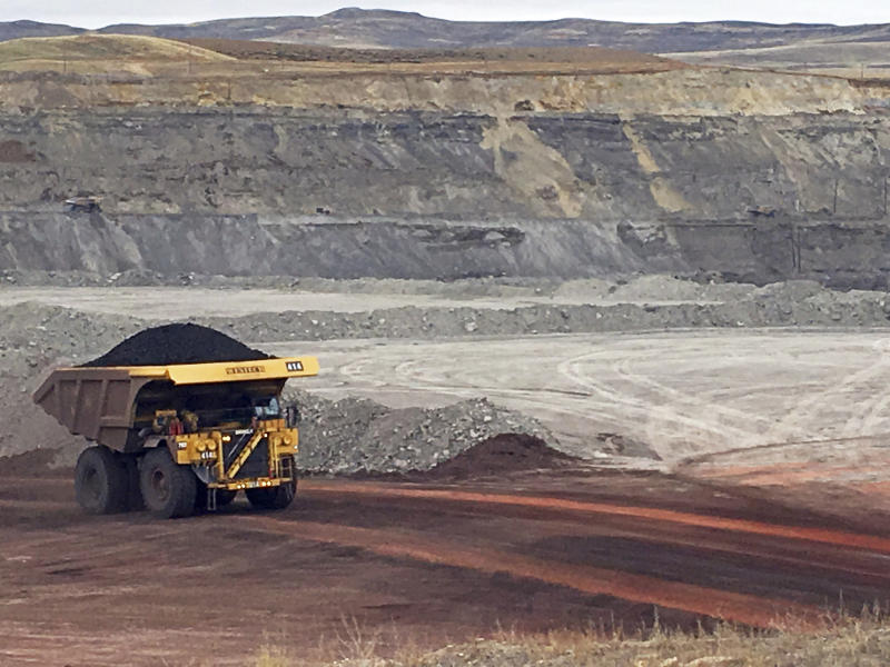 FILE - In this March 28, 2017, file photo, a dump truck hauls coal at Contura Energy's Eagle Butte Mine near Gillette, Wyo. Tennessee-based Contura Energy announced Monday, Oct. 21, 2019, that Blackjewel closed Friday on the sale of the Eagle Butte and Belle Ayr mines to a subsidiary of Alabama-based FM Coal. (AP Photo/Mead Gruver, File)