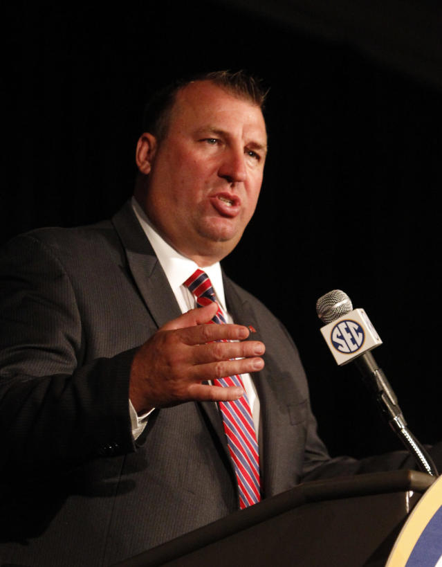 Arkansas coach Bret Bielema speaks to media at the Southeastern Conference NCAA college football media days on Wednesday, July 16, 2014, in Hoover, Ala. (AP Photo/Butch Dill)