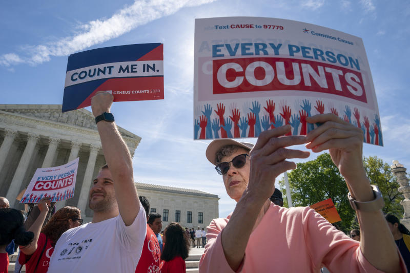 FILE - In this April 23, 2019, file photo, immigration activists rally outside the Supreme Court as the justices hear arguments over the Trump administration's plan to ask about citizenship on the 2020 Census, in Washington. Worried about internet trolls and foreign powers spreading false news, census officials are preparing to battle misinformation campaigns for the first time in the bureau's 230-year history. (AP Photo/J. Scott Applewhite, File)