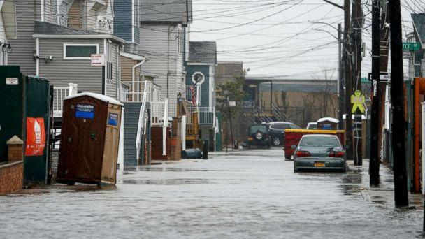 PHOTO: A car sits in high water on a flooded street during rain and high winds, March 2, 2018, in the Broad Channel section of Queens in New York.         (Don Emmert/AFP/Getty Images)