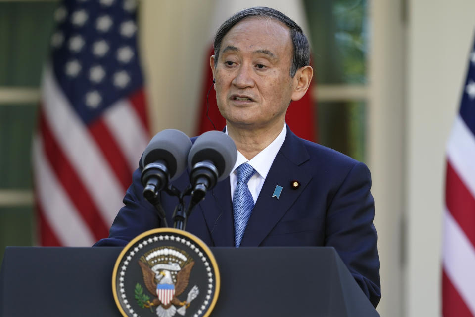 Japanese Prime Minister Yoshihide Suga, speaks at a news conference with President Joe Biden in the Rose Garden of the White House, Friday, April 16, 2021, in Washington. (AP Photo/Andrew Harnik)
