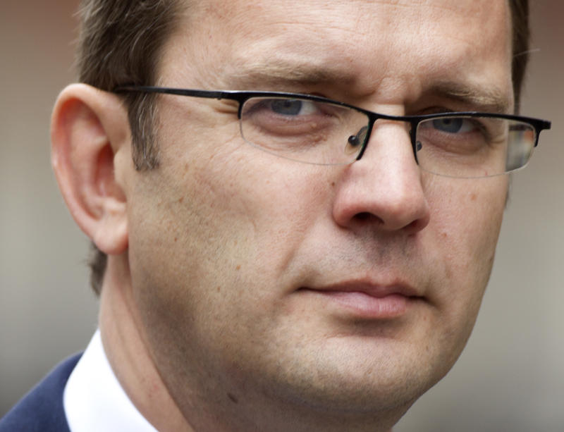 FILE - This is a Thursday, May 10, 2012 file photo of  Andy Coulson, the former editor of the News of the World newspaper and former director of communications for Britain's Prime Minister David Cameron as he arrives to appear at the Leveson Inquiry at the High Court in London, Coulson  was arrested by police Wednesday May 30, 2012  on suspicion of perjury.  Scottish police said Wednesday that Andy Coulson,  was detained at his home in London over an accusation of committing perjury at a case at the High Court in Glasgow. (AP Photo/Alastair Grant, File)