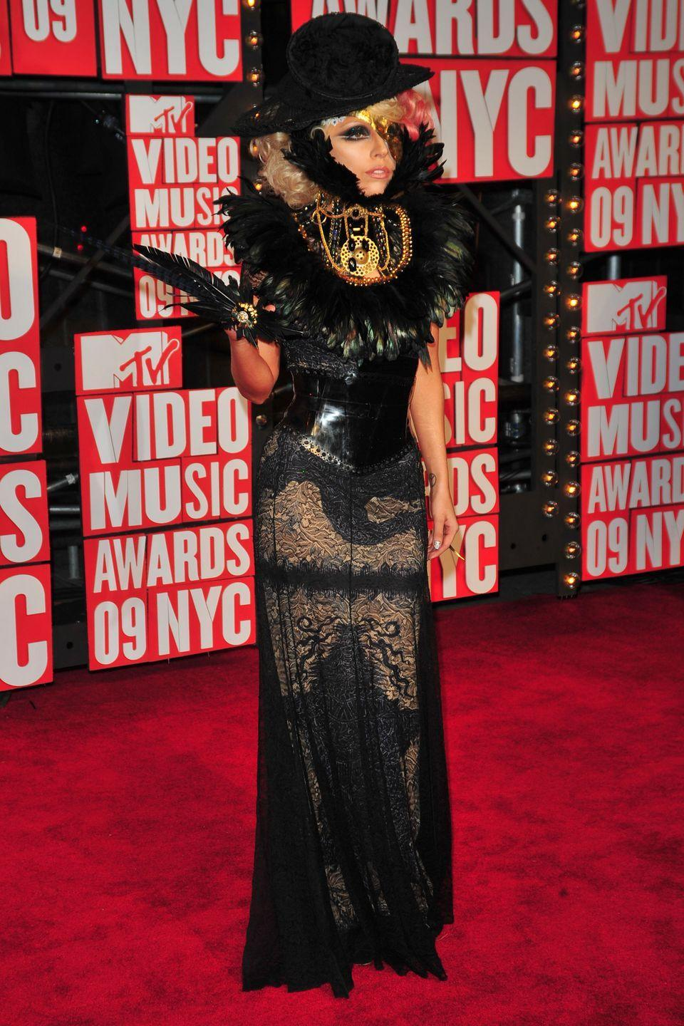 <p>Lady Gaga made a scene in this dramatic black feathered look at the 2009 awards show.</p>