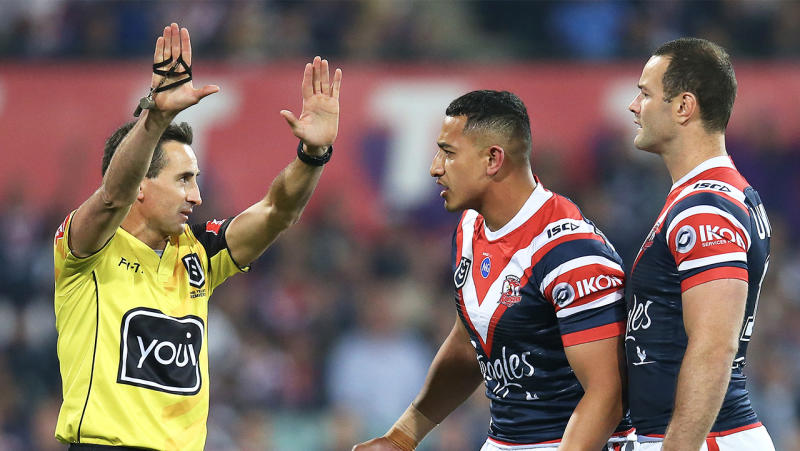Siosiua Taukeiaho (pictured middle) of the Roosters is sent to the sin-bin by referee Gerard Sutton.