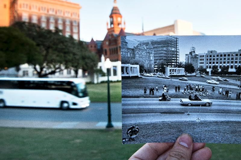 This file photo taken on November 8, 2013 shows a historic photo of post JFK assassination Dealey Plaza diplayed near its original location in Dallas, Texas