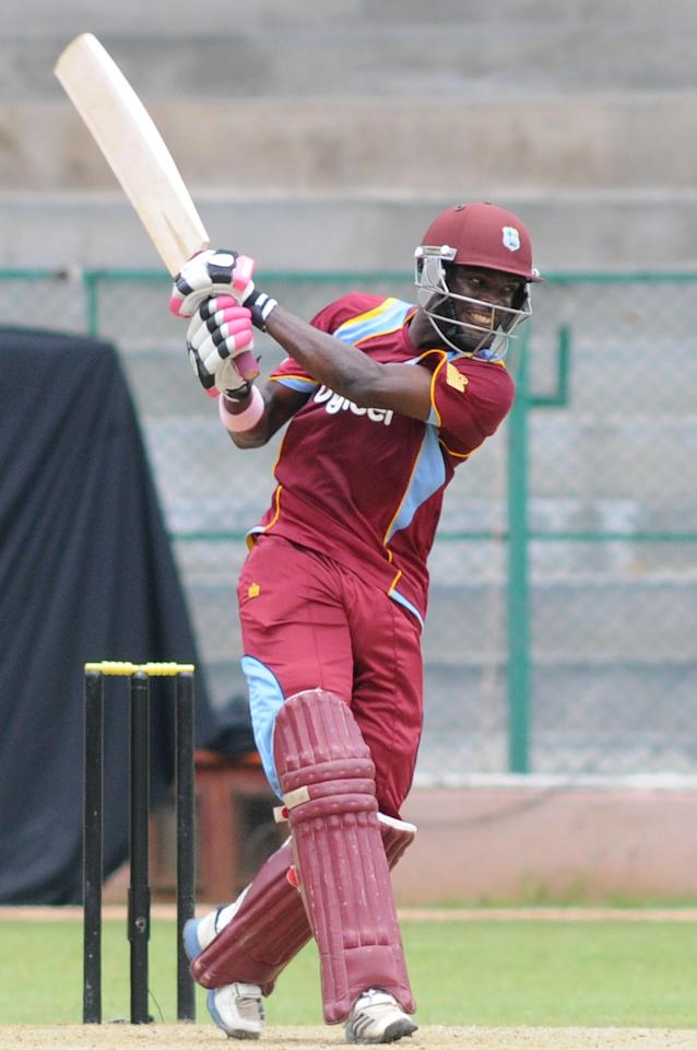 West Indies A player JL Carter in action during the ODI match between India A and West Indies A at M Chinnaswamy Stadium Bangalore on Sept. 17, 2013. (Photo: IANS)
