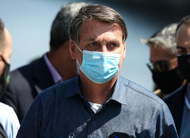 SAO VICENTE, BRAZIL - AUGUST 07: President of Brazil Jair Bolsonaro looks on during a visit to Barreiros bridge amidst the coronavirus (COVID-19) pandemic on August 7, 2020 in Sao Vicente, Brazil. The Barreiros Bridge project connects the mainland and island areas of São Vicente. After the completion of the services, the bridge will support vehicle traffic of up to three axes. (Photo by Alexandre Schneider/Getty Images)