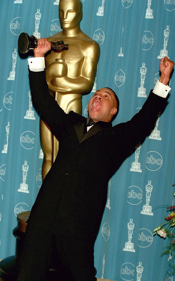 <p>After giving a very animated acceptance speech, the winner of Best Supporting Actor for 'Jerry Maguire' continued to celebrate backstage. (Photo: Frank Trapper/Getty Images) </p>