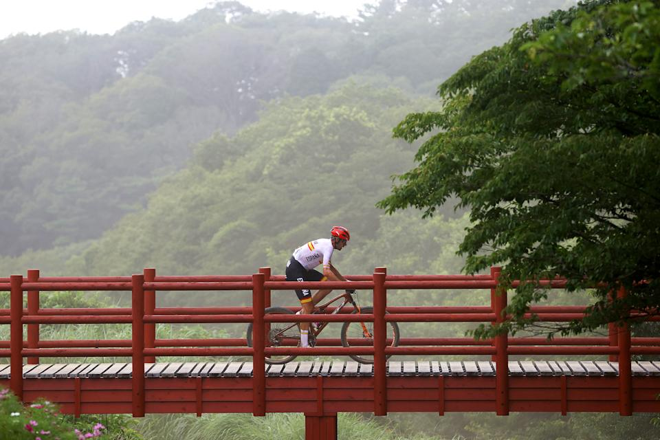 <p>IZU, JAPAN - JULY 26: David Valero Serrano of Team Spain crosses a bridge on the circuit during the Men's Cross-country race on day three of the Tokyo 2020 Olympic Games at Izu Mountain Bike Course on July 26, 2021 in Izu, Shizuoka, Japan. (Photo by Michael Steele/Getty Images)</p>