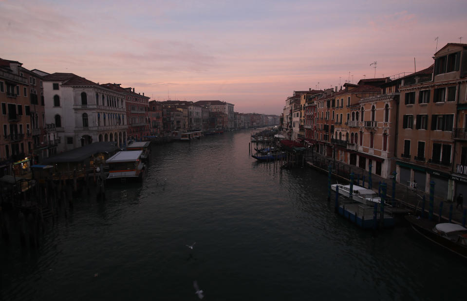 A view of the Canal Grande or Grand Canal, in Venice, Italy, Saturday, Jan. 30, 2021. The canal city's Carnival festivities should have started Saturday, but the COVID-19 pandemic made the annual appointment for more than two weeks of merry-making impossible. (AP Photo/Antonio Calanni)