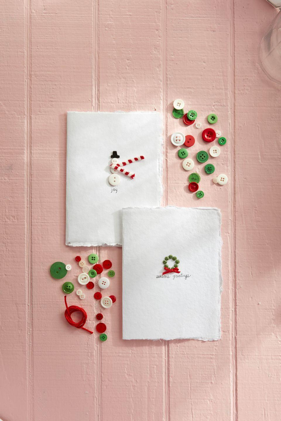 """<p>Transform the humble button into a festive greeting by using them to decorate the outside of an easy-peasy DIY holiday card. </p><p><strong>To make:</strong> Glue small buttons in the shape of a wreath or snowman to the outside of a plain card. Loop a <a href=""""https://www.amazon.com/Factory-Direct-Craft-Miniature-Christmas/dp/B07WSXY2QY/ref=sr_1_13"""" rel=""""nofollow noopener"""" target=""""_blank"""" data-ylk=""""slk:mini scarf,"""" class=""""link rapid-noclick-resp"""">mini scarf,</a> trimmed if necessary, under the button body and head of the snowman before attaching buttons; glue down ends of scarf to the card. Attach a hat, made from black felt with glue. Glue a tiny bow made from thin red ribbon to the wreath. Write a seasonal saying, if desired.</p><p><a class=""""link rapid-noclick-resp"""" href=""""https://www.amazon.com/Blumenthal-Lansing-2-Ounce-Buttons-Christmas/dp/B002Y2O0JY/ref=sr_1_6?tag=syn-yahoo-20&ascsubtag=%5Bartid%7C10050.g.3872%5Bsrc%7Cyahoo-us"""" rel=""""nofollow noopener"""" target=""""_blank"""" data-ylk=""""slk:SHOP BUTTONS"""">SHOP BUTTONS</a></p>"""