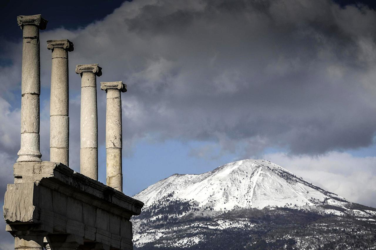 <p>The snow-covered peak of Mount Vesuvius volcano is seen from the archaeological excavations of Pompeii in Naples, southern Italy, Jan. 6, 2017. Large areas of Italy are affected by strong winds, snowfall and low temperatures. (Photo: CESARE ABBATE/EPA) </p>